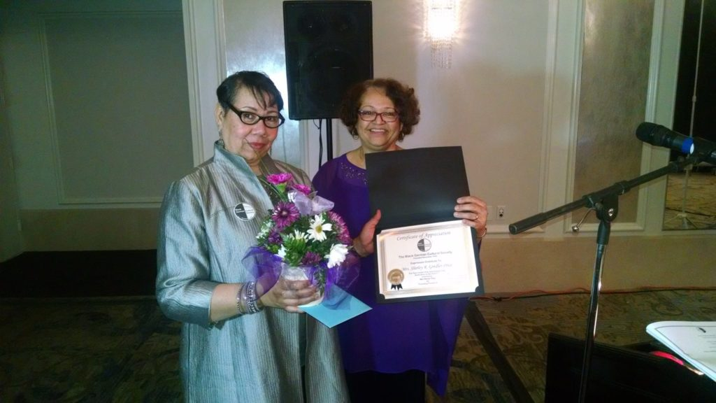 Surprise award given to Shirley Gindler-Price, Founding President of BGCS, presented by Honoree Henriette Hood-Cain, BGCS Secretary & Search Consultant & BGCS Family Member Angelika Scurlock